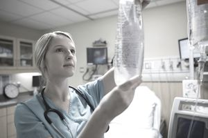 Nurse prepping IV bag