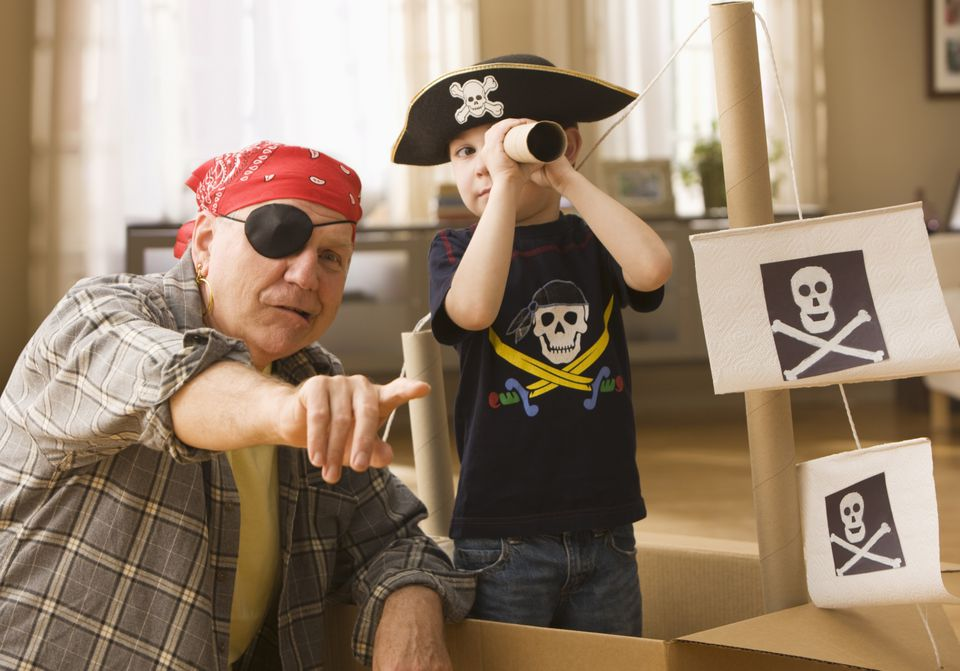 A grandparent and grandchild playing pirate