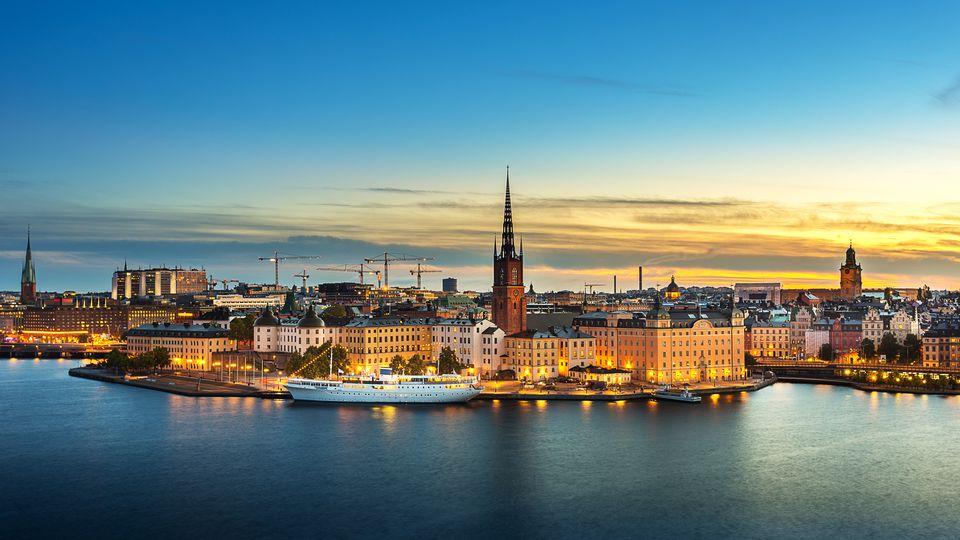 Sunset over Riddarholmen chruch in old town Stockholm city, Sweden