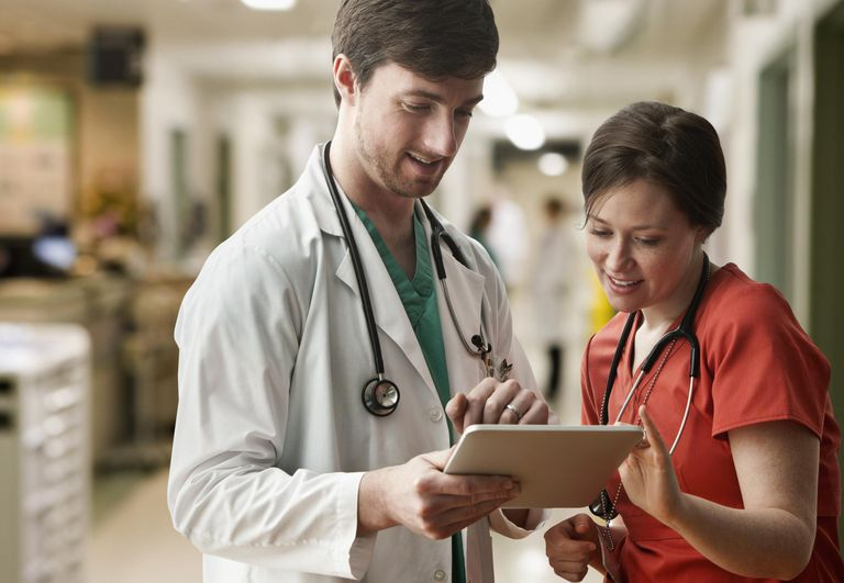 Caucasian doctor and nurse using tablet