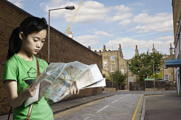 Portrait of woman looking at a street map