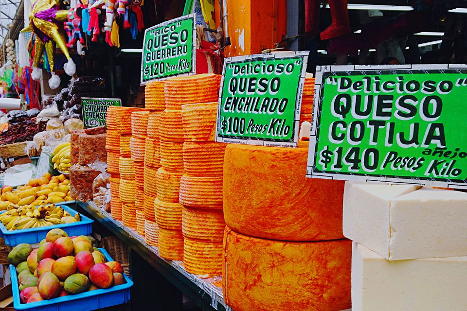 A stand of fresh Mexican cheeses