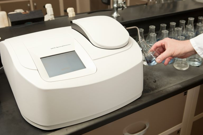 Lab Technician Testing Water with a Spectrophotometer