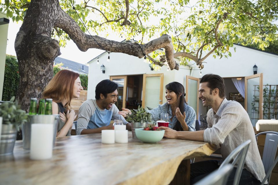 friends laughing on patio