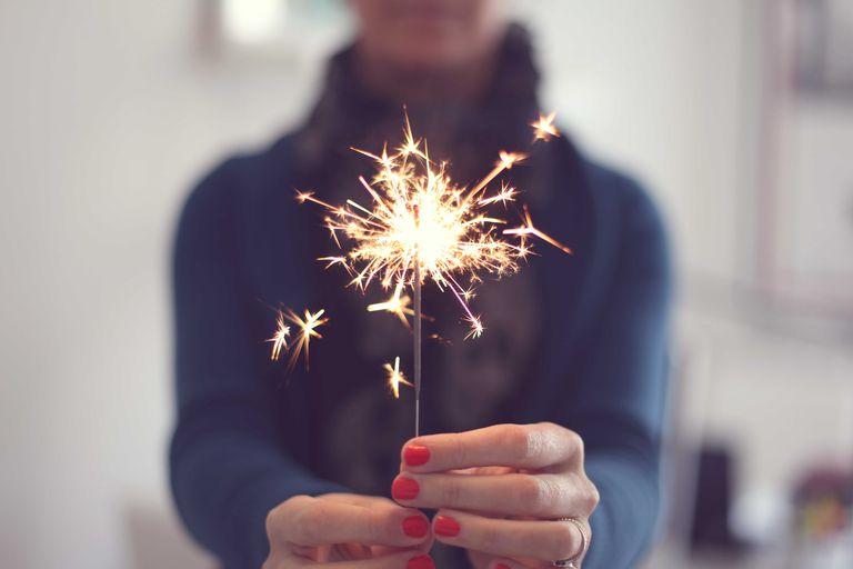 woman holding sparkler firework