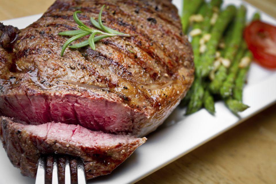 Grilled Rib Eye Steaks marinated in Lemon, garlic, and parsley