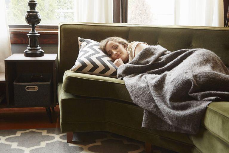 Woman asleep on sofa.