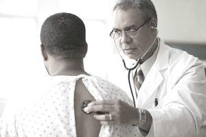 Respiratory therapist examining patient