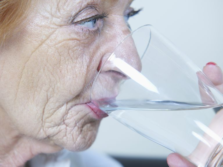 Senior woman drinking water