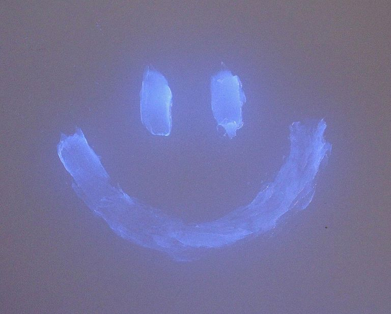 Petroleum jelly, such as Vaseline, glows bright blue under a black light.