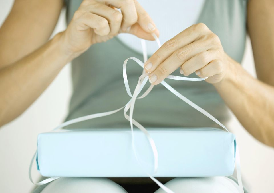 Woman wrapping present.