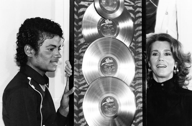 Michael Jackson (1983) presented with the first Triple Platinum awards