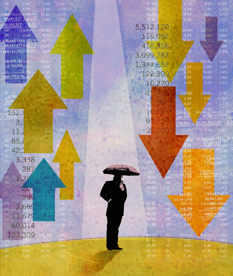 Businessman holding umbrella standing between rising and falling