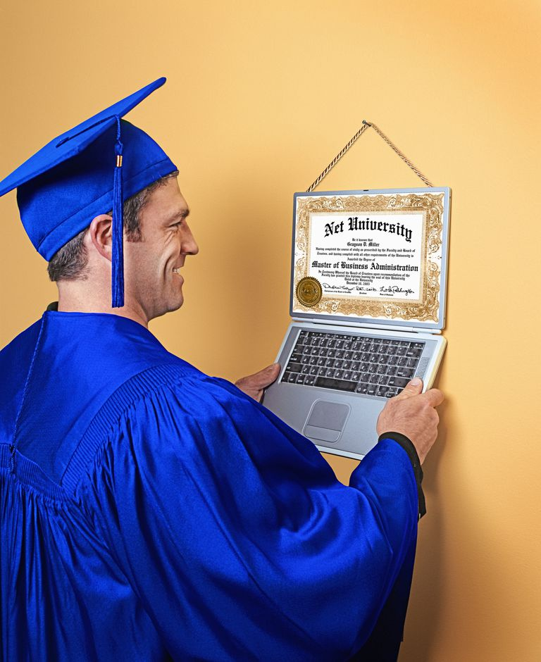 Graduate hanging up online college diploma