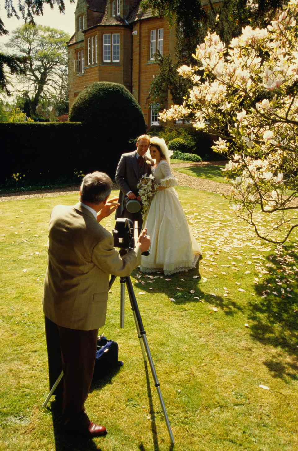 wedding photographer and newlywed couple
