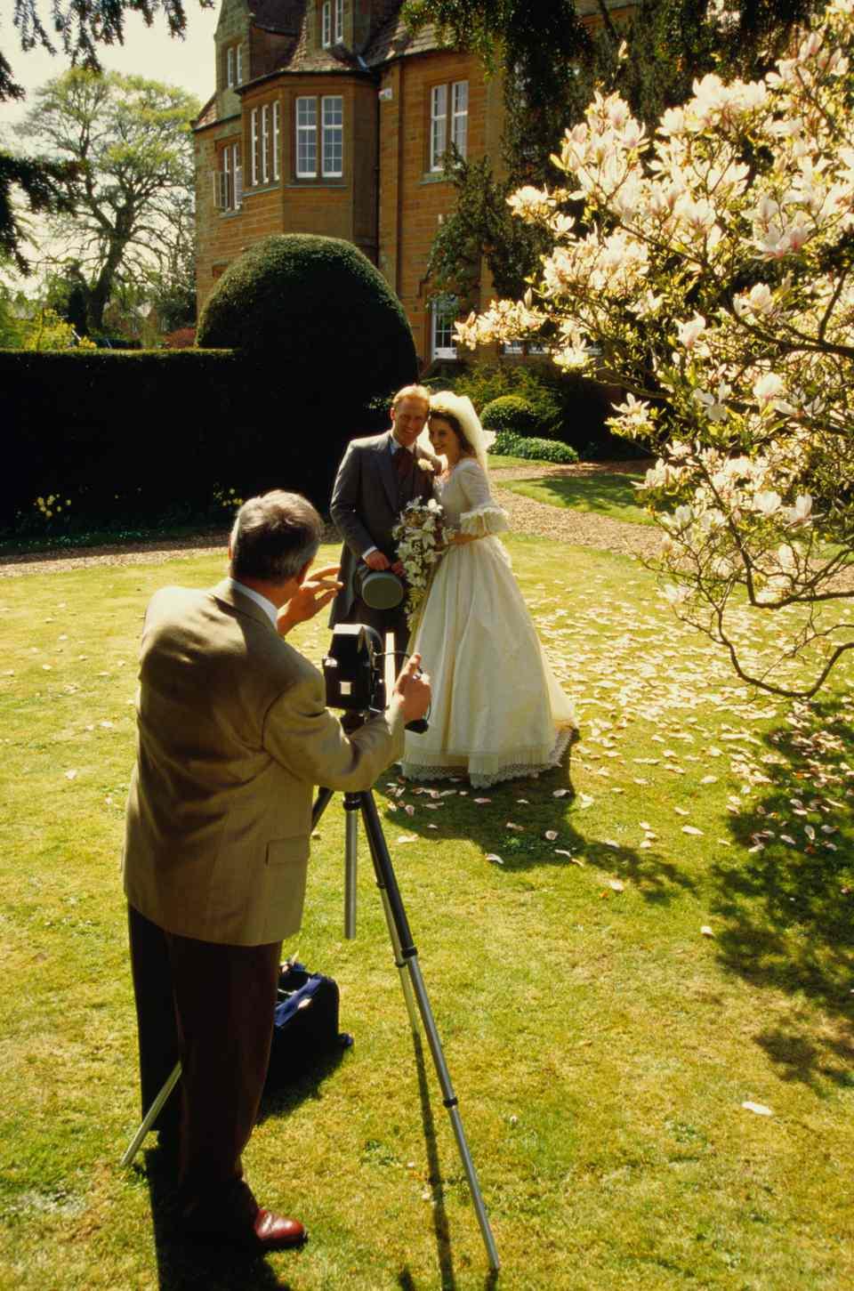 wedding photographer and newlywed couple