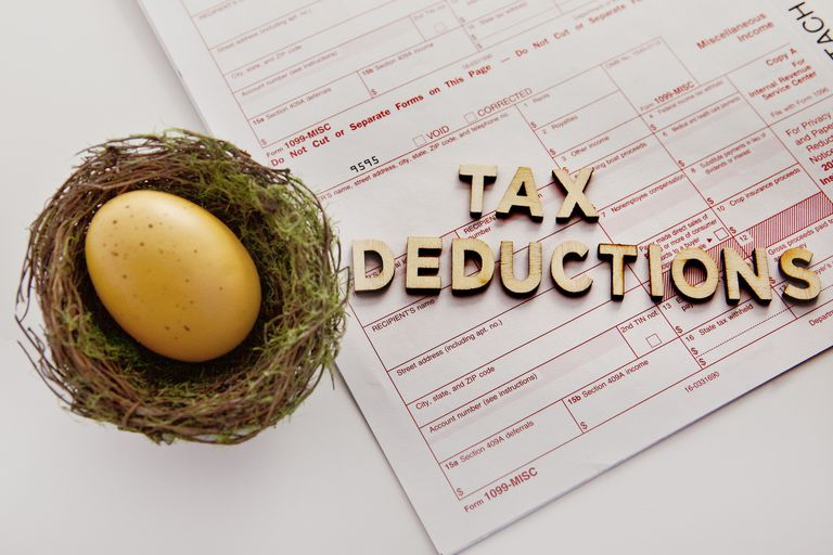 1099 tax form and golden egg in a nest