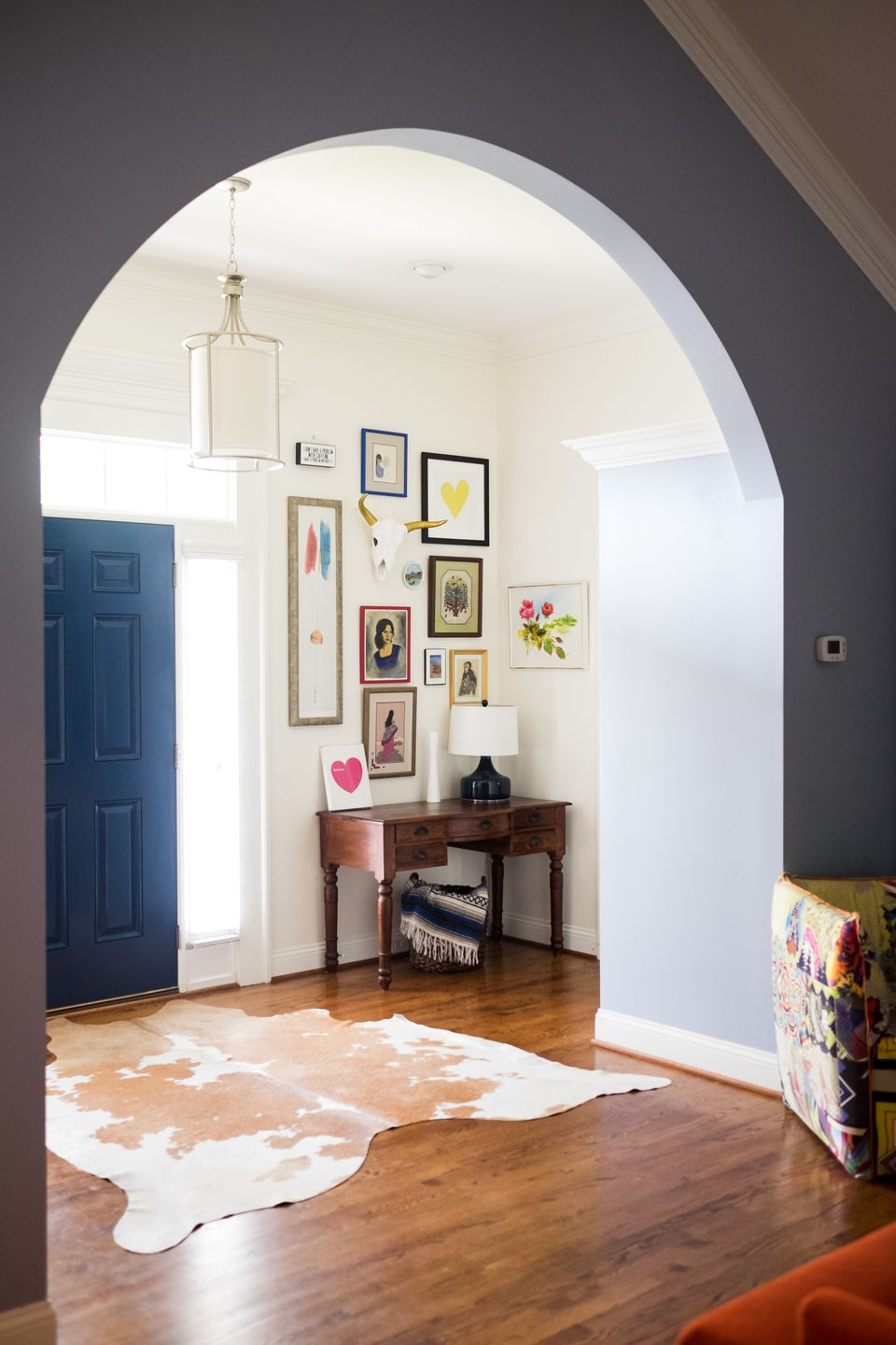 gallery wall entryway with cowhide rug