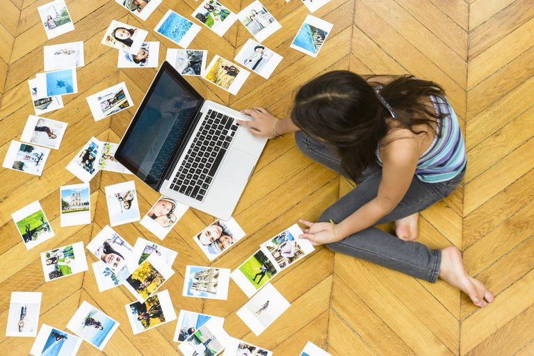 Girl using computer to scan photos