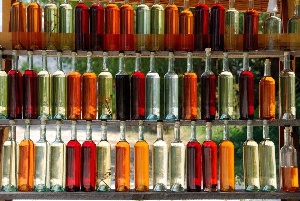 A Wall of Colorful Homemade Liqueurs