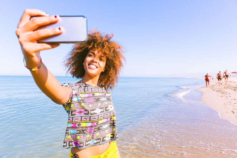 Girl taking selfie on vacation