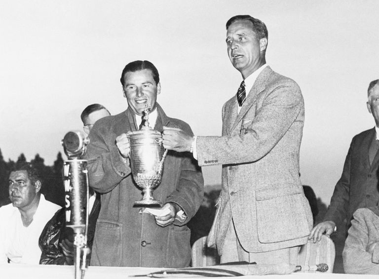 Sam Parks Jr. (left) receives the trophy from USGA President Prescott Bush after winning the 1935 US Open