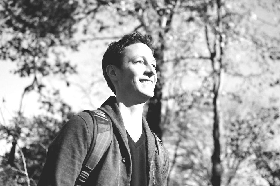 Portrait of Eliot Schrefer, smiling outside