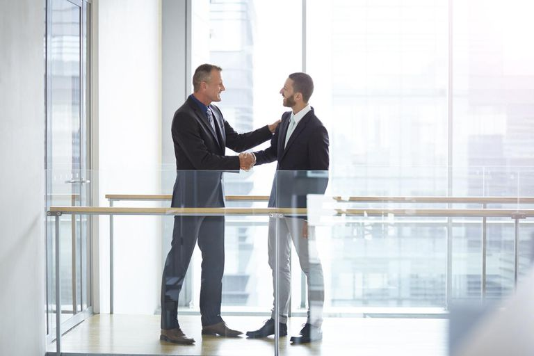 Businessmen making handshake