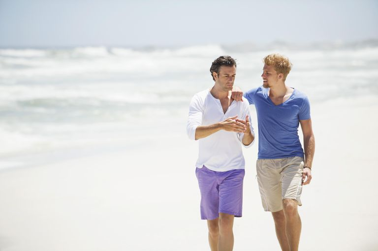 Two men walking on the beach