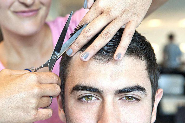 Man having hair cut, closeup
