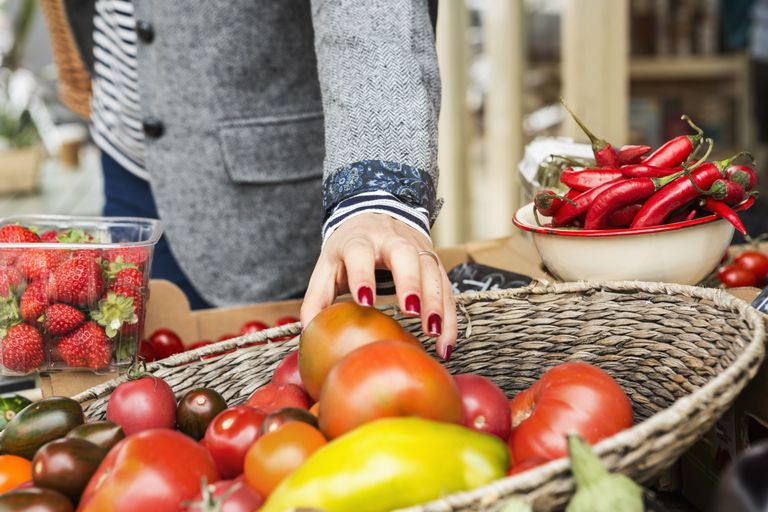 woman choosing veggies