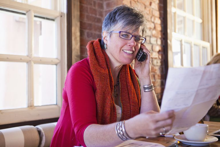 Older employee considers her retirement letter as she makes future plans.