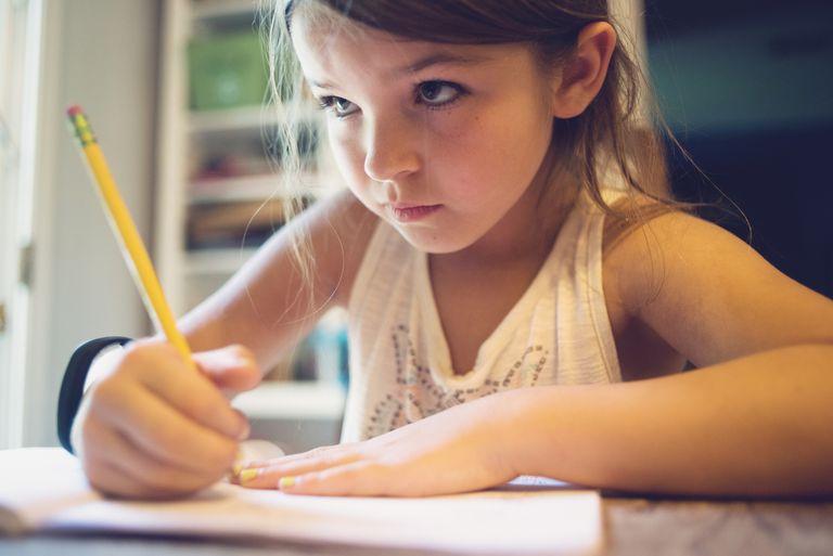 Young girls doing her homework