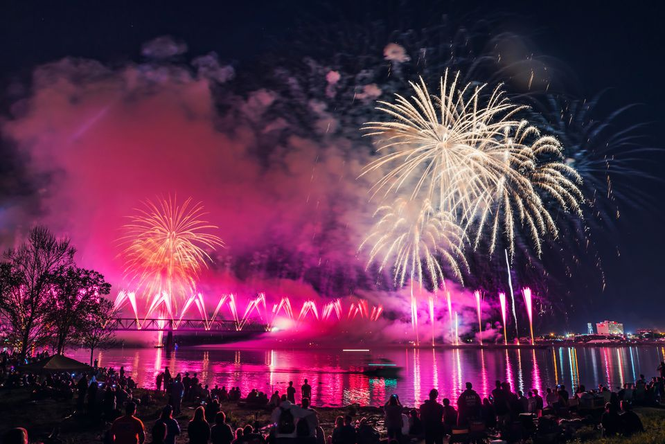 People By Lake Looking At Illuminated Fireworks During Night