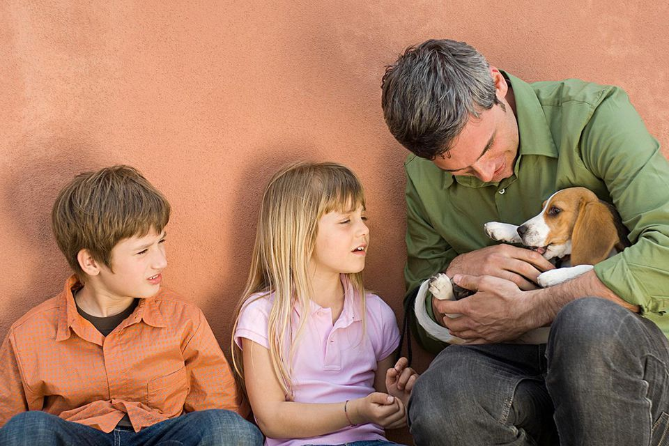 Father and kids with beagle