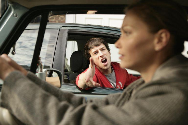 Man yelling at woman driving car