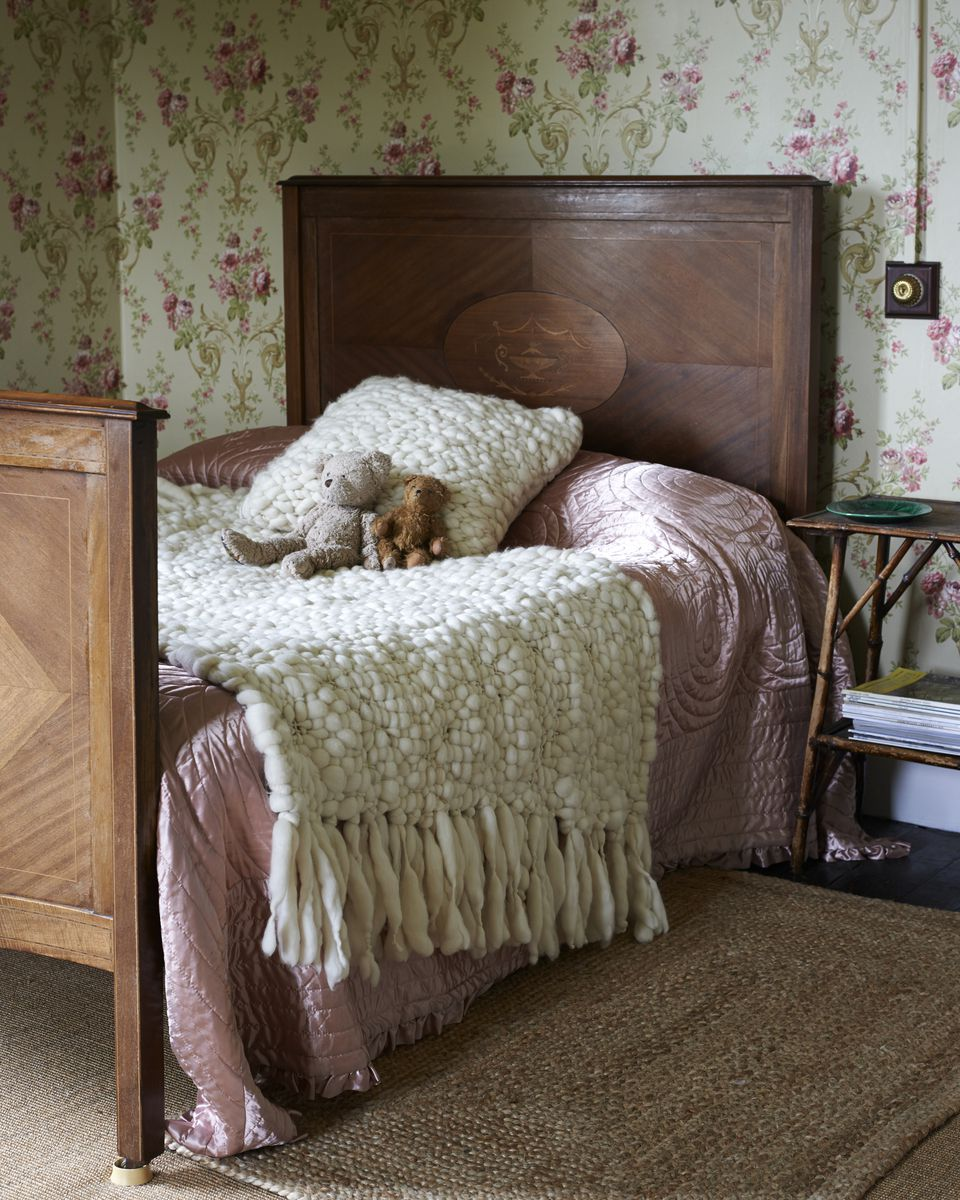 Antique bed with woolen blanket and pillow