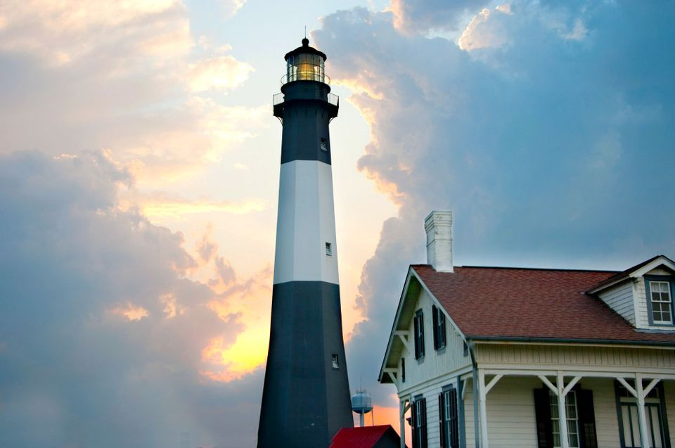 The black-and-white Tybee Island Lighthouse at sunset