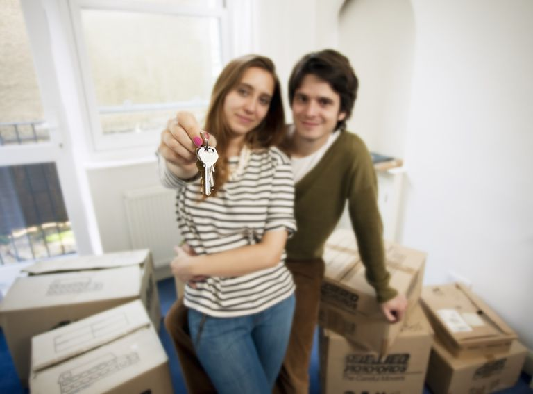 Young couple moving into their first home