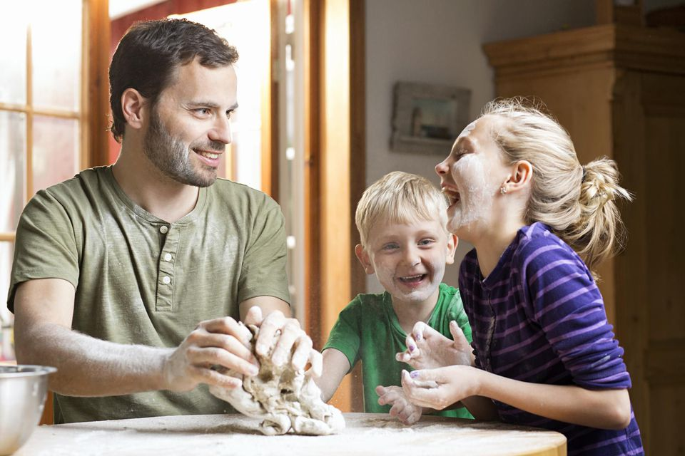 dad baking with two kids