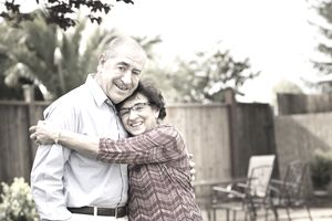 Elderly spouses smiling and hugging. Can one of them claim the other as a dependent?