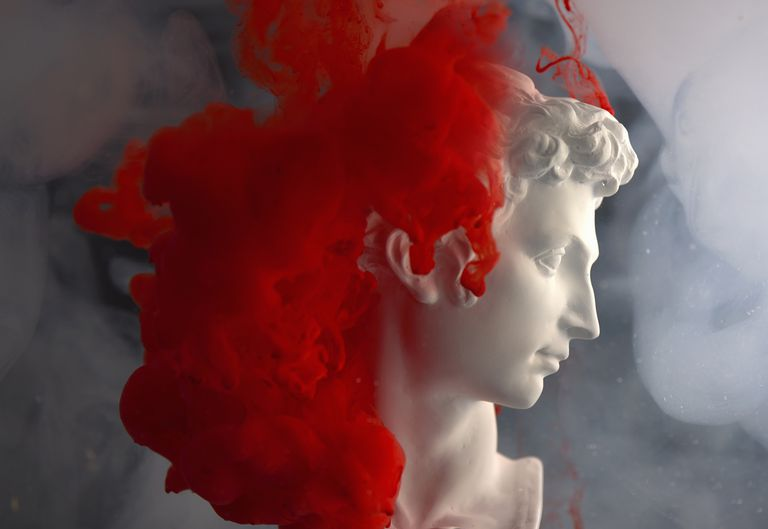 Greek god with red paint