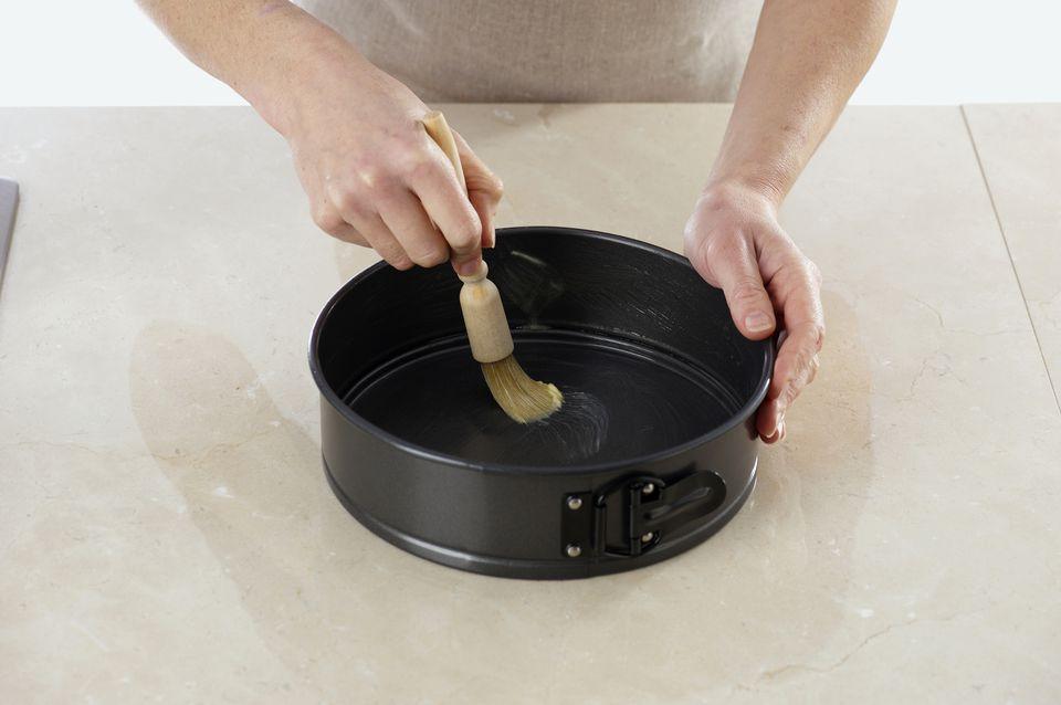Greasing cake tin