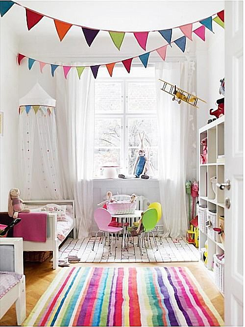 White nursery with bright, colored accents