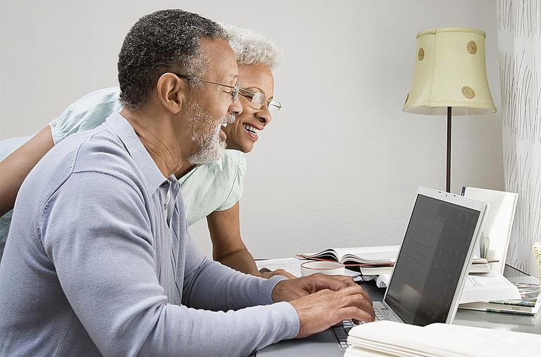 Couple in their home office