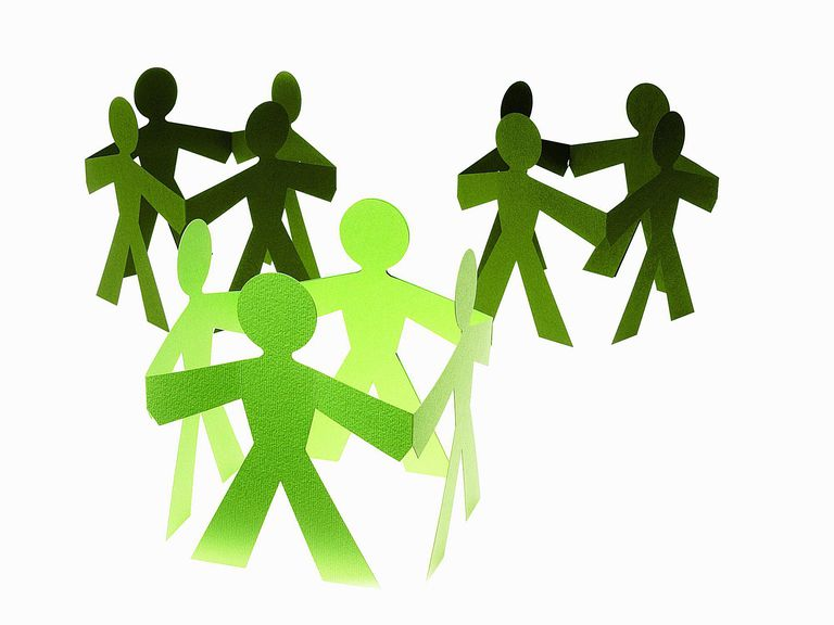 Paper dolls hold hands, symbolizing social networks and the field of sociology.