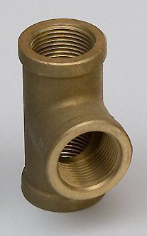 This is a plumbing fitting made of brass, an alloy of copper and zinc.