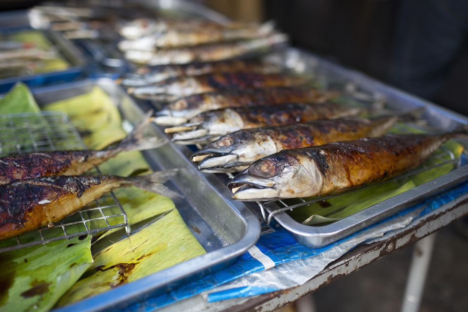 Barbecued sardines on sale at Maeklong market