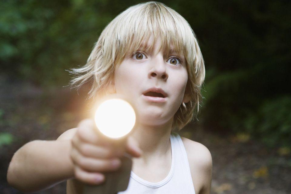 grandson playing flashlight tag