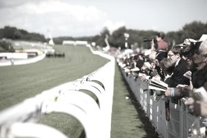 Crowds on the rails watching the racing at Glorious Goodwood.
